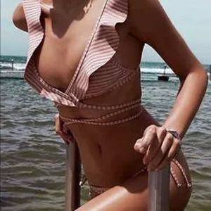 none Swim - Pink swimsuit with ruffles